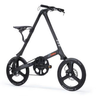 STRIDA C1 Black Carbon - 1 versnelling - 18 inch - c1 - Carbon - Carbon frame - carbon wielen - design fiets - design vouwfiets - driehoekig - driehoekige - driehoekige vouwfiets - fiets - kopen - lichtgewicht - nieuw - opvouwbare fiets - Plooibare fiets - Plooifiets - plooifiets kopen - plooifietsen kopen - strida - strida design vouwfiets - super lichtgewicht - te koop - unieke vouwfiets - vouwfiets - vouwfiets kopen - vouwfietsen - vouwfietsen kopen - vouwfietsenwinkel - winkel