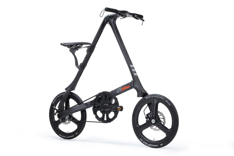 STRIDA C1 Black Carbon - 18 inch - bike - Buy foldable bikes - Buy folding bicycle - Buy folding bike - Buy folding bikes - buying - c1 - carbon - carbon frame - Carbon wheels - collapsible bike - Design bike - Design folding bike - foldable bike - Folding bicycle - Folding bike - Folding bike shop - Folding bikes - for sale - Lightweight - new - shop - Single speed - strida - Strida design folding bike - super lightweight - Triangular - Triangular folding bike - Triangular shaped - unique folding bike