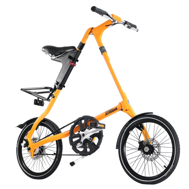 STRIDA SX Matte Orange - 1 versnelling - 18 inch - design fiets - design vouwfiets - driehoekig - driehoekige - driehoekige vouwfiets - fiets - kopen - lichtgewicht - nieuw - opvouwbare fiets - Plooibare fiets - Plooifiets - plooifiets kopen - plooifietsen kopen - strida - strida design vouwfiets - sx - te koop - unieke vouwfiets - vouwfiets - vouwfiets kopen - vouwfietsen - vouwfietsen kopen - vouwfietsenwinkel - winkel
